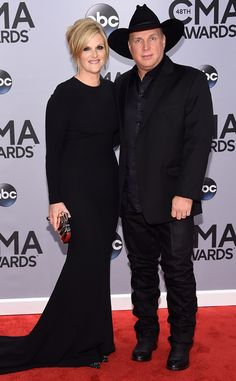 The married couple coordinates all-black ensembles.