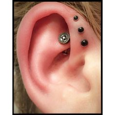 Triple forward helix I did at @saintsabrinas with onyx cabs from @neometaljewelry . She had great anatomy to place these further inwards than I traditionally do them. We also slapped on a 14k Rhodium Harlequin end with a black cz on her healed rook piercing.