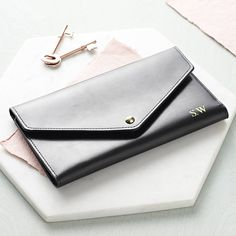 Stunning personalised travel document wallet. Perfect gift for her!Add a little luxury by having your initials monogrammed at no extra cost. Choose up to 3 upper case characters in silver or gold which we will emboss in the position shown. If you would like help with your engraving requirements then please contact us via 'Ask the seller a question' where we will be happy to advise you. Adding your initials to any item in our collection will make it truly unique. Allow our personalisation…