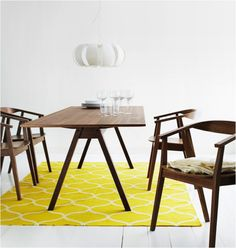 ikea stockholm dining chairs & round table. i like the little
