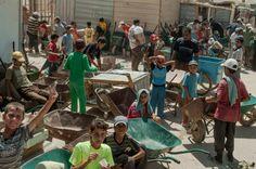 Syrian refugee children line up for work in Za'atari refugee camp in Jordan. UNHCR / G. Beals