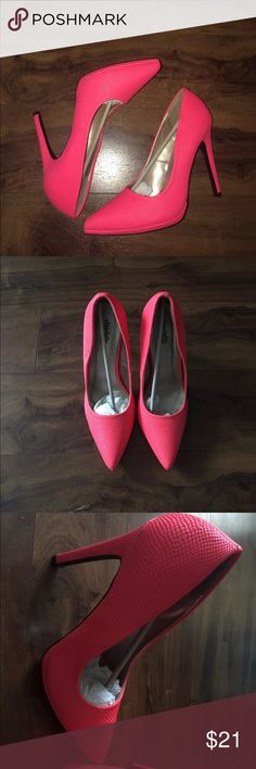 Neon Coral pumps New in box.  Outside of heels on both shoes have a small scuff.  Size 10. Heels are NEON CORAL NOT HOT PINK!!! Charlotte Russe Shoes Heels