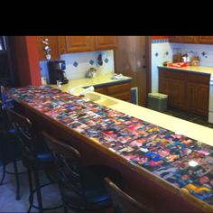 Bar top, pictures topped with Epoxy Resin. Great idea.