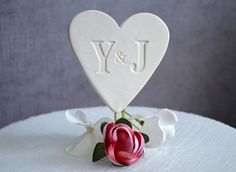PERSONALIZED Heart Wedding Cake Topper with Initals $28.99. This personalized ceramic cake topper would look so beautiful on a wedding cake! This is a heirloom piece you can display next to your wedding photo and keep for years to come.