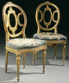 A PAIR OF RUSSIAN NEO-CLASSICAL CARVED GILT WOOD DINING CHAIRS, circa 1800. Provenance: Prince Andrei Nikolaivich Sherbatov, Sherbatov Palace, St. Petersburg (according to the consignor). Prince Andre Sherbatov was a General who fought in the Russian-Turkish Wars and took part in the Seige of Silistra, June 10, 1810 and commanded the 18th Division at the Battle of Gorodetschna 1812.