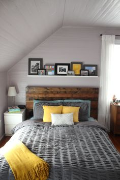 Mustard and greys. Love the shelf over the headboard.