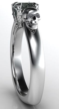 """Our """"Angels and Demons"""" Engagement Ring 2 with a Black Diamond Center and White Diamond Eyes."""
