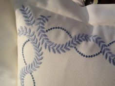 Detail of embroidered bedding by DEA