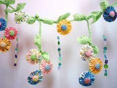 April Showers bring May Flowers garland (made from pack of charm squares and some pretty beads and buttons)