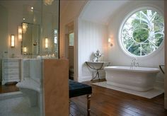 What a window....love the curve of the bench in the shower!