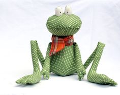 Green Polka Dot Frog. Handmade, stuffed frog toy wearing an orange scarf. You can kiss him to win the Prince's love. He is 10 inches (25 cm) when sitting and 23 inches (57 cm) overall. AUD $30.34.