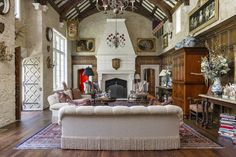 The great hall, which reaches 2½ stories, is pictured. Marguerite Green designed the interiors of the home in an English style, Ms. Reeves said. Most of the objects in the house are antiques.