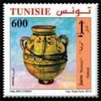 """Subject  Tunisian traditional pottery items : Big Jar """"Borniya""""  Number  1908  Size  36x36 mm  Issue Date  23/03/2012  Number issued  500 000  Serie  Ordinary  Printing process  offset  Value  600 millimes  Drawing  Hela Ben Cheikh"""