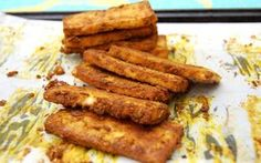 This curried tofu is crispy, flavorful, and an easy to make. Pressing the tofu in this recipe prepares it to absorb the flavorful curry-inspired spices of the marinade and also allowed the tofu to crisp up while baking.