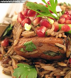 Chicken with rice and pomegranate seeds