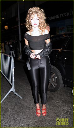 Gigi Hadid Channels Sandy From Grease for Halloween 2015!: Photo #3497391. Gigi Hadid sports super curly hair and tight spandex pants while dressing up as Sandy from Grease for Heidi Klum's 2015 Halloween Party held at LAVO on Saturday…
