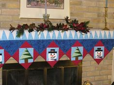 Quilt, Mantle quilt made for my parents.  Paper pieced the Christmas Tree and Snowman that I created.  Made in 2007