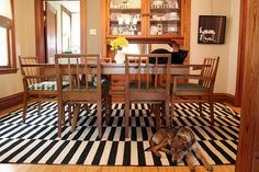 Making it Lovely: Black and white Ikea stockholm rand rug and dining furniture.