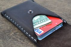 Beautiful and practical mini wallet made from genuine harness - saddle leather. Perfect for credit cards and folded bills. The molded. Holds 10 standart