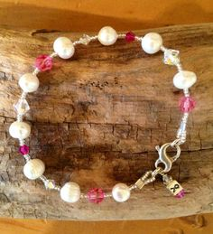 http://www.shopbellaperlina.com/collections/bella-perlina-jewelry/products/deanna-our-breast-cancer-bracelet-made-of-pink-and-clear-swarovski-crystals-and-freshwater-pearls DEANNA BRACELET – bellaPerlina Jewelry