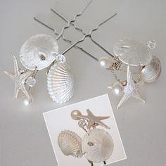 Seashell hair pins would be beautiful for a beach wedding. If you want the best officiant for your Outer Banks, NC, ceremony, contact Rev. Barbara Mulford: myobxofficiant.com/