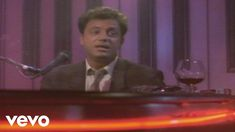 """Billy Joel - Piano Man (Video) I heard this this evening and got """"that feeling"""" that told me this somehow connects to the (as-yet-unwritten) next book in the series.... Certainly not in timeframe, but there's something universal about the lyrics and the melancholia that lurks behind the """"cheerful"""" melody."""