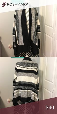 A.N.A. Sweater EUC (used once).  This sweater is shades of black, gray and cream.  Super soft and very comfy.  Front ends hang down lower than back. a.n.a Sweaters