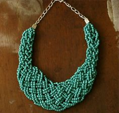Bohemian Inspired Turquoise Braided Bead Statement Necklace with Silver Chain Detail. $45.00, via Etsy.