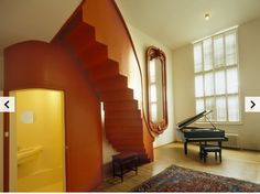 #Wooden #Staircase in room. Lloyd Hotel - Condé Nast Traveler
