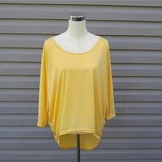 Yellow Hi-Lo Top Yellow 3/4 Sleeve Hi-Lo Top   This is NWOT Retail. Price Firm Unless Bundled Tops