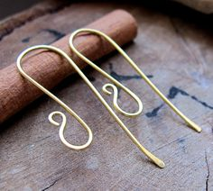 Long Brass Ear Hooks- Very lightweight and stylish, these are a chosen design for small charms and dangle beads. These wires are measured at 45mm in length and made with 20 gauge wire. Lightly hammer on one side and at the tip for added style and strength.