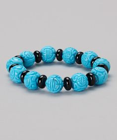 Take a look at this Turquoise & Onyx Carved Bead Stretch Bracelet by KWAN COLLECTIONS on #zulily today!