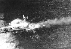 TBF Avenger attacking destroyer Takikaze aground on coral reef in Truk Lagoon - 1944