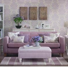 Full-on feminine lavender shades have been teamed with pale purple seating and a lilac rug and footstool to create a traditional country scheme that oozes style and sophistication. Wallpaper, sideboard and rug Laura Ashley Sofa and armchair SofaSofa