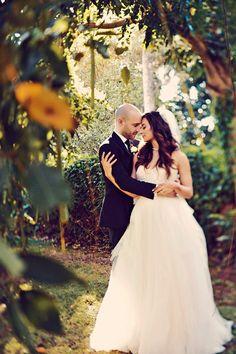bride and groom, photo by Tamiz Photography http://ruffledblog.com/haiku-mill-wedding #weddingportrait