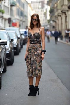 Chanel sunglasses, Tiffany necklaces, Bottega Veneta dress, Celine cuff, Dior Homme watch, Saint Laurent boots.