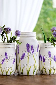 Lavender Flower Mason Jars: We don't know what's more beautiful: the painted lavender flowers on the Mason jar, or the real ones inside.Click through to find more pretty mason jar flower arrangements to try this summer.