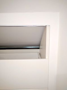 This IKEA hack is to create a built-in under-eaves wardrobe for our attic bedroom roof using IKEA's METOD kitchen cabinet series.