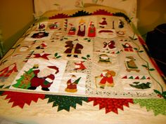 Santa Quilt - designed by my sister Lynne, my cousin Sandy & I. Each of us made one & altho the center is the exact pattern we used different fabrics & borders so each one is individual.