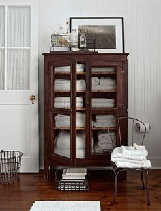White towel-filled armoire in a bathroom photographed by Peter Margonelli. Source: Alexa Hotz blog.