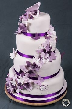 I like this style cake but with flowers instead of butterflies