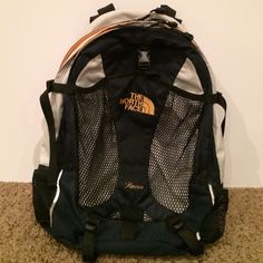 The North Face Recon backpack The North Face Recon backpack. Features 2 large pockets, front mesh pouch and 2 water bottle holders in each side. Smaller pocket has organizer pockets for pens, pencils, ID and a clip for keys.  Only wear is on back as seen in picture 4. The North Face Bags Backpacks