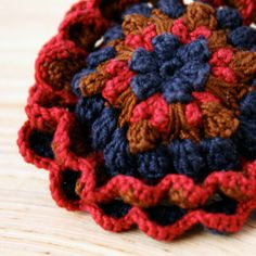 Crochet Brooch Flower in Brown Blue and Red by BrandlessBerta, €25.00