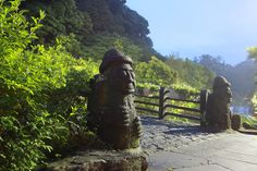 The famous phallic basalt old grandfather statues of Jeju