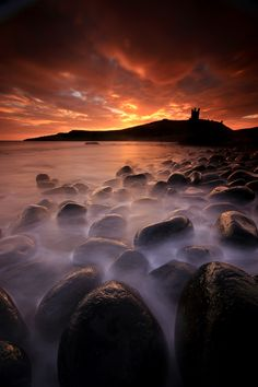 Fire and Water - A great morning at Dunstanburgh. After travelling up through the rain we didnt have high expectations, but you've got to be in it to win it as they say! As soon as we parked up the clouds started to break up and we were rewarded with a fab sunrise.