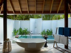 """Dusit Thani Maldives!  """"Fancy a dip?? 10 of our beach villas have plunge pools in the spacious outdoor garden bathroom... 5 of them have pools facing the beach on the front deck"""""""