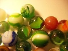 Marbles have been valued by collectors for nearly 100 years. Collectors must quickly identify a vintage marble, recognize its manufacturer, spot any flaws and have an in-depth knowledge of the . Marbles Images, Marble Pictures, Marble Price, Marble Games, Marble Art, Glass Marbles, Classic Toys, Rare Antique, Color Splash