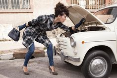Woman driving Fiat 600 in Rome