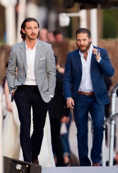 Shia LaBeouf and Tom Hardy in classy tailored suits.