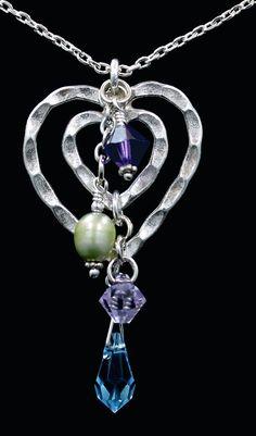 Silver heart pendant w/amethyst crystals.